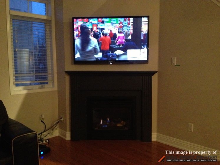 Bridge-Style Power Kit installed over fireplace 1-2