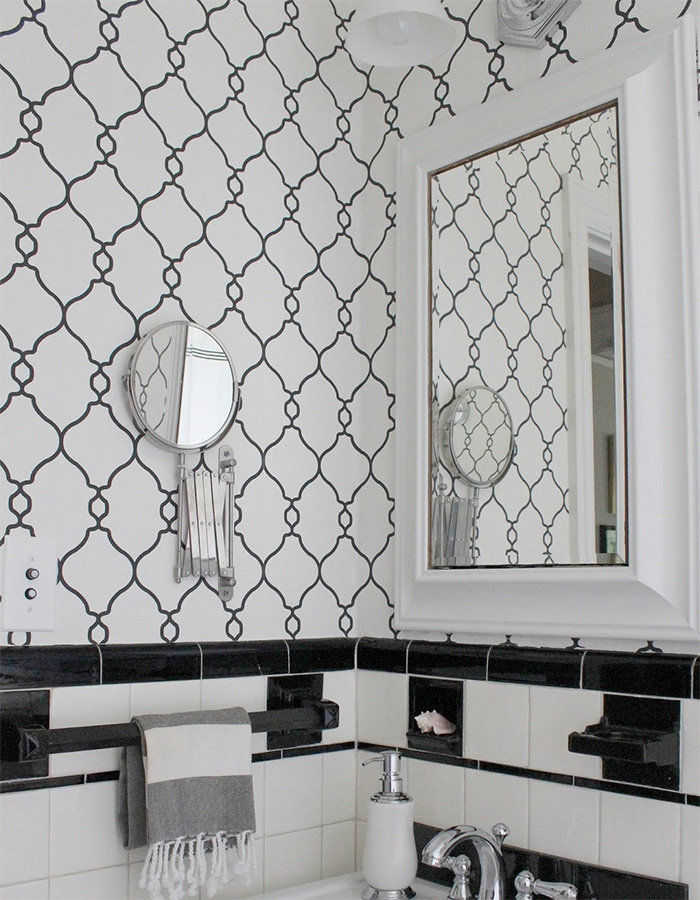 black and white lattice trellis wallpaper in the bathroom by walls republic