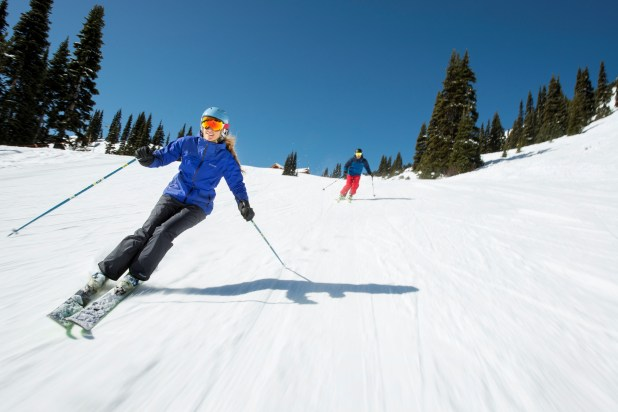 women downhill skiing