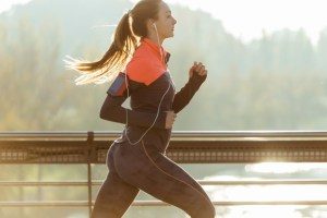 healthy-woman-running-with-blurred-background_23-2147600427