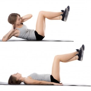 woman-lying-on-the-floor-while-doing-sit-ups_1163-885