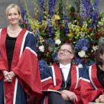 Author JK Rowling (L) stands before bein
