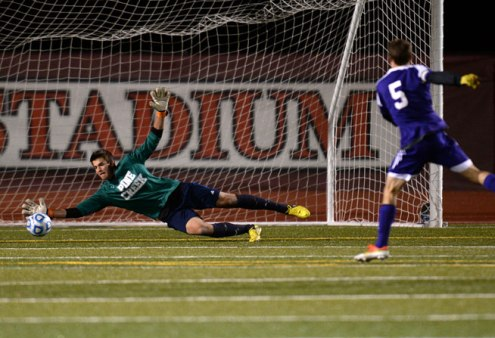 Goalkeeper David Meyer of Pine Creek High School (1) saves the goal from Mason Douillard of Boulder High School (5) in the 2nd half of the game at Legacy Stadium in Aurora on Nov. 6, 2013. Pine Creek won 1-0 in OT. (Hyoung Chang, The Denver Post)