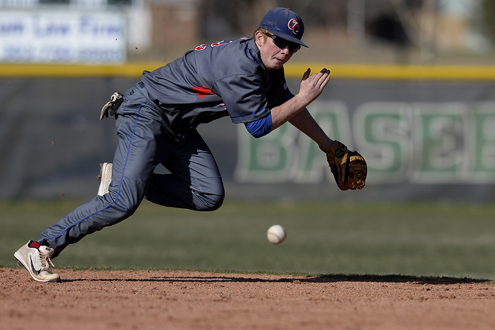 Ryan Robb (2) of the Cherry Creek Bruins dives for a ball that squeezes through the hole during the fourth inning of action. Overland hosted Cherry Creek on Tuesday, April 8, 2014. (AAron Ontiveroz, The Denver Post)