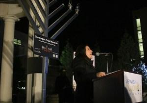 GW Chabad President Juliette Bergwerk introduces the menorah lighting event in Kogan Plaza on Monday night. Desiree Halpern | Photo Editor