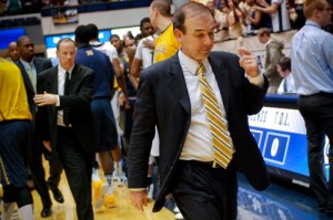 Head coach Mike Lonergan exits the court last season. Hatchet File Photo