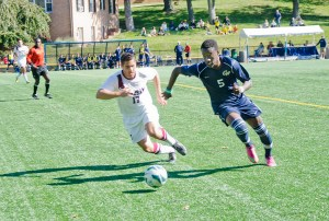Freshman midfielder Tobi Adewole chases after Fordham junior defense Eric Walano in GW's 2-0 win Sunday. Dan Kolonay | Hatchet Photographer