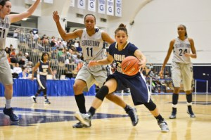 Sophomore Alexis Chandler tries to ward off a Georgetown defender earlier this season.  Hatchet File Photo