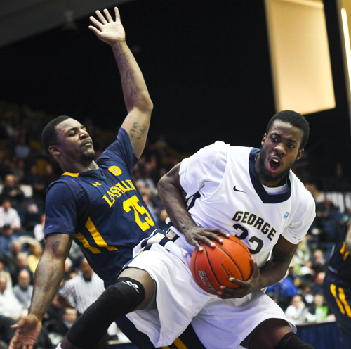 Isaiah Armwood collides with La Salle's Jerrell Wright in GW's big win over the Explorers Wednesday night. Cameron Lancaster | Assistant Photo Editor