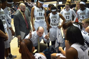 Head coach Jonathan Tsipis strategizes and motivates his team during a huddle earlier this season. Hatchet File Photo