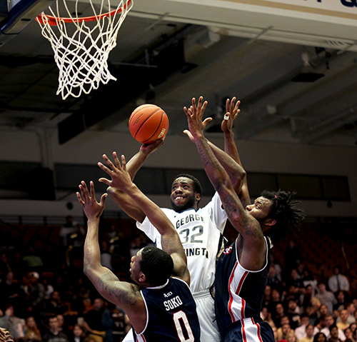 Isaiah Armwood goes up against Duquesne defenders Wednesday night. Cameron Lancaster | Assistant News Editor
