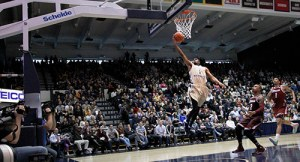 Graduate transfer Maurice Creek puts in a layup against UMass Saturday. The Colonials surrendered their first home loss of the season, 67-61. Andrew Goodman | Hatchet Staff Photographer