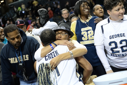 Guard Maurice Creek gets a hug after Friday night's game in Brooklyn. Samuel Klein | Photo Editor