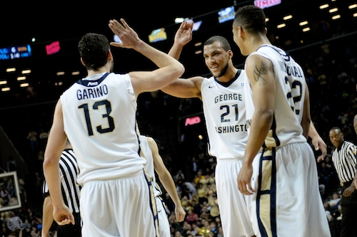 Patricio Garino, Kevin Larsen and Joe McDonald celebrate in GW's 85-77 win. Samuel Klein | Photo Editor