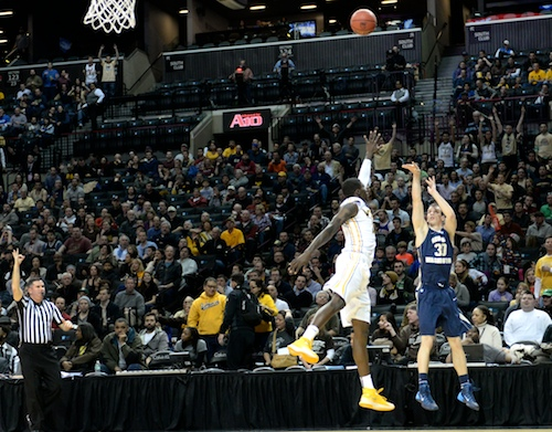 Senior Nemanja Mikic fires a three in the first half. Mikic carried GW with his hot shooting again on Saturday. Samuel Klein | Photo Editor
