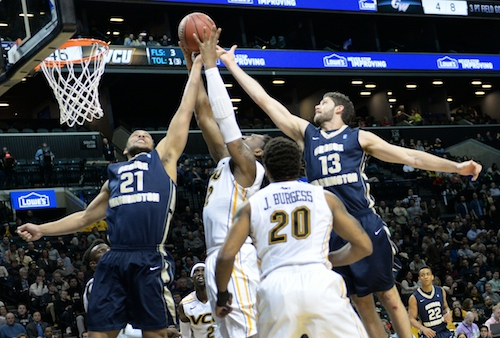 Patricio Garino and Kevin Larsen try to stop a VCU player on Saturday. Samuel Klein   Photo Editor