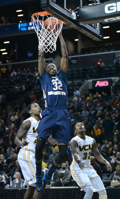 Senior Isaiah Armwood slams home a dunk Saturday for two of his team-high 15 points. | Samuel Klein | Photo Editor