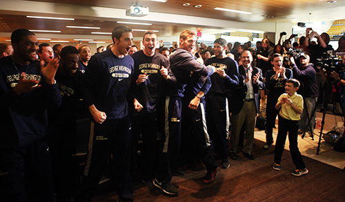 GW players and fans celebrate as GW is given a No. 9 seed in the NCAA Tournament's East region. Cameron Lancaster | Assistant Photo Editor