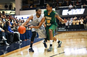 Graduate guard Maurice Creek looks for a pass during a game against George Mason last week. Hatchet File Photo