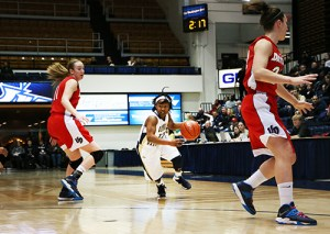 Graduate student guard Danni Jackson drives past a Dayton defender Saturday. The Colonials topped the Flyers 88-79 to clinch at least the fourth seed in the Atlantic 10 Championship. Caitlin Harrington | Hatchet Photographer