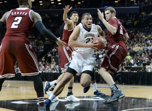 Kevin Larsen drives past Derrick Gordon in GW's Atlantic 10 quarterfinals win in Brooklyn, N.Y. Cameron Lancaster | Assistant Photo Editor