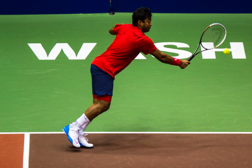 Leander Paes of the Washington Kastles stretches to return a serve. Zach Montellaro | Hatchet Staff Photographer