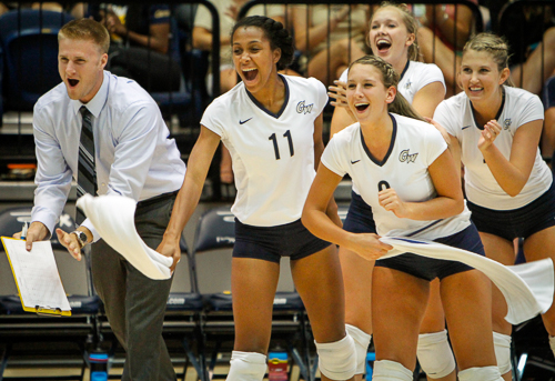The volleyball's bench cheers after winning a point over Auburn on Friday. Hatchet File Photo by Andrew Goodman | Hatchet Staff Photographer