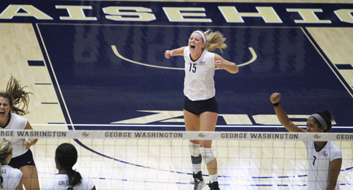 Women's volleyball celebrates against Rhode Island earlier this season. Hatchet File Photo