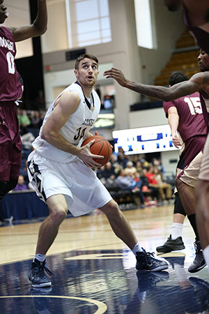 Senior forward John Kopriva drives to the basket in an exhibition game earlier this season. Kopriva had a career night Wednesday as the Colonials topped Longwood 91-66. | Hatchet File Photo.
