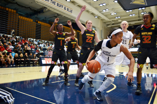 Senior Chakecia Miller dribbles past the Maryland defense. The Colonials fell to the Terrapins 65-75 at the Smith Center on Saturday. Aly Kruse | Hatchet Photographer