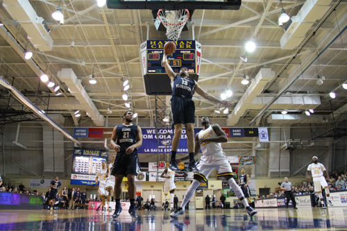 Patrico Garino goes up for a dunk in GW's 63-50 loss to La Salle on Saturday. The Colonials lost their fourth game of the season, each one having come on the road. Dan Rich | Hatchet Staff Photographer