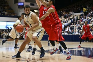 Kevin Larsen protects the ball against a double-team. Larsen's rebounding helped the Colonials outdo Richmond 43-24 off the boards, allowing the Spiders just two offensive rebounds. Cameron Lancaster | Photo Editor.
