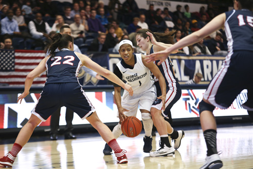 Senior Chakecia Miller dribbles past Duqesne's defense Tuesday night. The Colonials squashed the Dukes 83-56, remaining undefeated in conference play. Cameron Lancaster | Photo Editor