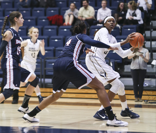 Junior Jonquel Jones receives the ball outside the paint in GW's last home game against Duquesne. Jones contributed a game-high 16 rebounds in GW's 67-48 win over La Salle on Saturday. The Colonials tallied 63 boards in the game, the most since 2008. Cameron Lancaster | Photo Editor.