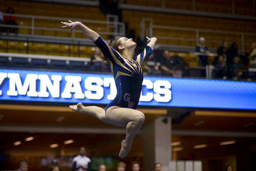Freshman Jillian Winstanley leaps into the air as she completes her floor routine.