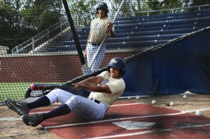 Junior Eli Kashi tests his core strength with a drill during batting practice. Dan Rich | Contributing Photo Editor