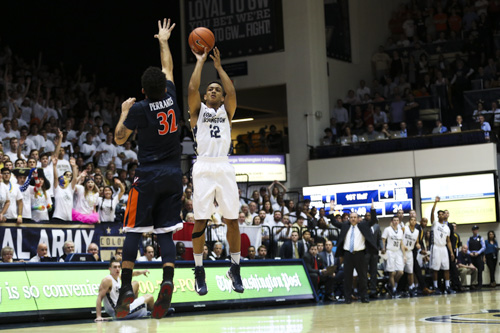 Senior guard Joe McDonald fires a three in the Colonials' upset win over No. 6 Virginia. Dan Rich | Contributing Photo Editor