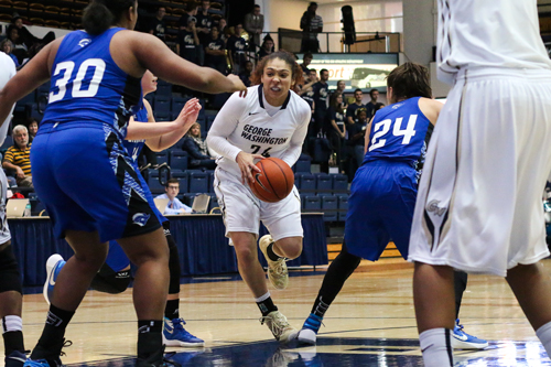Senior Alexis Chandler drives to the basket in GW's exhibition game. Chandler played in front of a crowd from her home state of Texas in GW's double overtime win over Iowa Friday. Jordan McDonald | Hatchet Staff Photographer