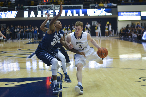 Sophomore guard Paul Jorgensen drives to the hoop in GW's victory over Saint Peter's. Jorgensen is set to transfer out of the men's basketball program this offseason. Ashley Le | Hatchet Photographer