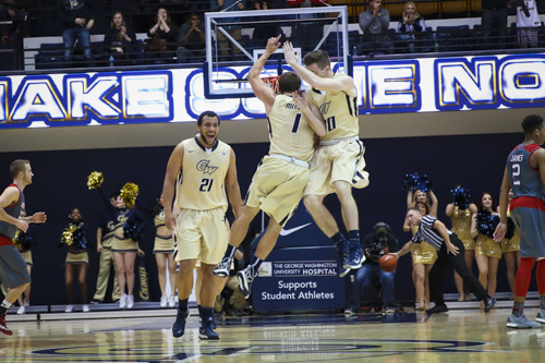 Alex Mitola and Matt Hart celebrate a three-point shot in the Colonials' 91–64 win over Duquesne on Jan. 9. GW travels to Pittsburgh Wednesday for its second meeting with the Dukes this season.  Dan Rich | Contributing Photo Editor