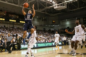 Senior point guard Joe McDonald drives in for a layup in GW's win against VCU Saturday. McDonald scored 11 points and added five rebounds. Cameron Lancaster | Senior Staff Photographer