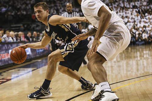 Graduate student Alex Mitola contributed five points off the bench in GW's win. Cameron Lancaster | Senior Staff Photographer