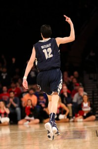 Sophomore guard Yuta Watanabe celebrates a three-pointer in GW's win over San Diego State Tuesday in the NIT semifinals. Dan Rich | Contributing Photo Editor
