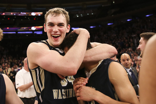Junior Tyler Cavanaugh hugs a teammate after GW's win. Dan Rich | Contributing Photo Editor