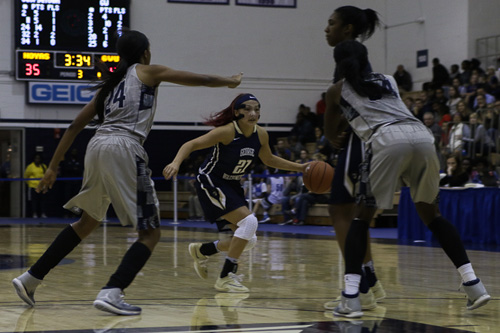 Sophomore guard Mei-Lyn Bautista drives the ball against a Georgetown opponent during Friday's loss. Bautista scored a team-high 8 first-half points in the game. Ethan Stoler | Hatchet Photographer