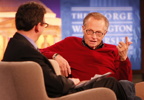 Larry King speaks to School of Media and Public Affairs Director Frank Sesno about his long career in journalism. Michelle Rattinger/Assistant Photo Editor