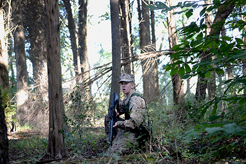 Combat-oriented training is one of the many types of training midshipmen go through during their time in the unit. Sophomore Jerry Callan practices the basics of fire team patrols through a wooded area.