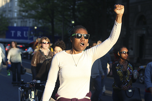 Bria Gibson marches with other protestors towards Pennsylvania Ave. Desiree Halpern | Photo Editor