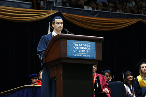 Chris Evans, the student speaker for the Columbian College of Arts and Sciences called on officials to improve mental health policies on campus. Olivia Anderson | Contributing Photo Editor