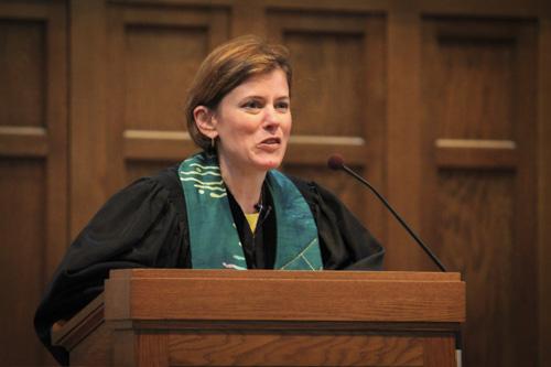 Reverend Laura Cunningham speaks at the interfaith service at the Western Presbyterian Church. Anne McBride | Hatchet Staff Photographer